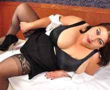 Fat Latin mature playing with her huge breast