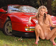 Beautiful naked girl and beautiful red ferrari testarossa