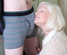 Platinum blonde British granny playing with much younger boy